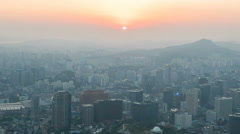 Time lapse. Seoul city hazy sunset day to night scene. View from Seoul Tower. - stock footage