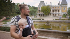 Father holding his young son. They travel together Stock Footage