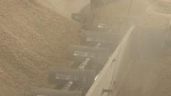 Scraper loader delivers grain, screw conveyor to load Stock Footage