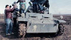 Fathers With Children Climbs On Old WWII Germany Tank - stock footage