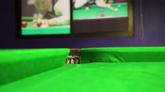 Billiard ball rolling into a hole on a pool table Stock Footage