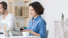 Cheerful beautiful woman working in the call center - stock footage