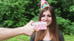 Beautiful Woman Opening a Birthday Gift. a Woman Very Happy. Girl Standing in a - stock footage