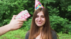 Woman Opens a Gift on Birthday. She is Very Happy. Slow Motion. Stock Footage