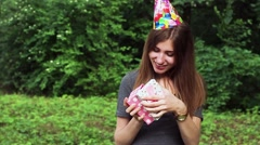 The Girl Opens a Gift on the Day of Birth. Slow Motion. Stock Footage