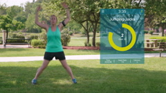 Woman Jumping Jacks Graphics in City Park Stock Footage