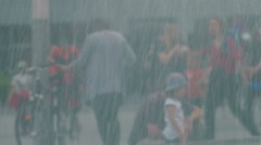 People in the City near Fountain Flow Close-Up, rain effect - stock footage