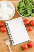 Food journal with bowls of food Stock Photos