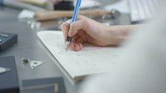 4K Close up of jewelry designer at work in studio, sketching out designs - stock footage