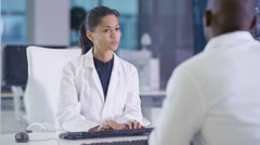 4K Scientists in white coats using interactive touch screen in lab Stock Footage