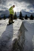 Snowboarder standing on half-pipe Stock Photos