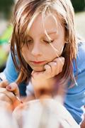 Bored girl painting outdoors Stock Photos