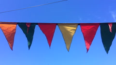Little triangular flags or bunting waving In the wind - stock footage