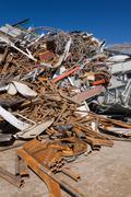 Pile of rusty metal at scrap yard - stock photo