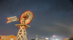 Old-fashioned windmill starry night sky timelapse Stock Footage