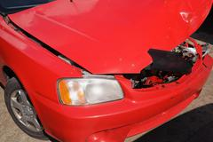 Smashed red car bonnet - stock photo