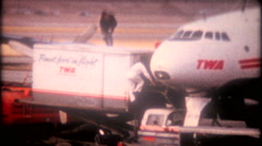 3347 ground crew prepares passenger airplane for flight -vintage film home movie Stock Footage