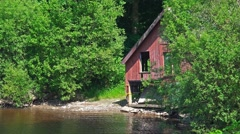 Establishing Shot: Old disused boat house Stock Footage