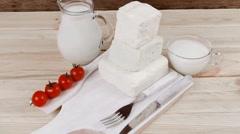 Fresh white greek goat sheep feta cheese on plate with milk Stock Footage