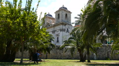 Man takes photo at Church in the park of Turia Stock Footage