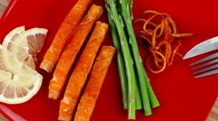 Salmon slices with asparagus lemon fried orange peels Stock Footage