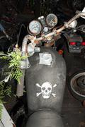 Skull and crossbones on motorbike fuel tank - stock photo