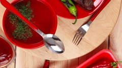 Bbq roast beef steak on red plate with soup sauce and pepper Stock Footage