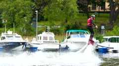 Testing water jet pack flyboard for the first time inside a river failure at end - stock footage