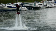 Testing the water jet pack flyboard for the first time inside river in the city - stock footage