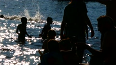Crowd of silhouette unrecognized people playing enjoying water and beach Stock Footage