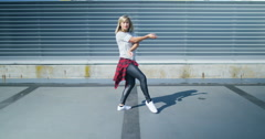 4K Young urban street dancer showing off some moves in urban environment Stock Footage