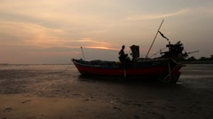 Beautiful silhouette fishing boat and Sunset over the sea. Stock Footage