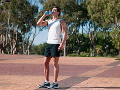 Young man drinking mineral water - stock photo