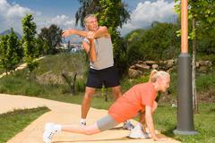 Mature couple stretching before exercise Kuvituskuvat
