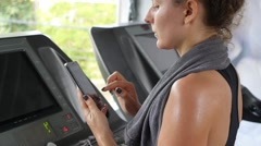 Athletic Young Female Using Cellphone at Sport Gym - stock footage