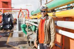 Worker standing on oil rig Stock Photos