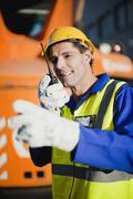 Worker using walkie talkie on site Kuvituskuvat