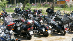 Motorcycle rally. Motorbikes on a car park Stock Footage