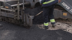 Workers apply asphalt to road. People filling the hole on the street. Stock Footage