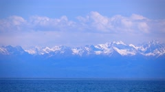 Kyrgyzstan, Issyk Kul lake and snow covered mountains. 4K telephoto lens shot Stock Footage