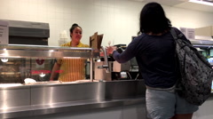 Slow motion of woman asking for spoon at food court area inside Ikea store - stock footage