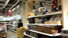 Worker stocking sale item inside Ikea store Stock Footage