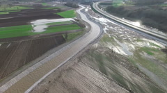 Aeria view of flood aftermath inspection on a highway construction site. Stock Footage