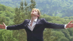 Businessman feeling free spreading arms on top of the world two shots 4K Ultr - stock footage