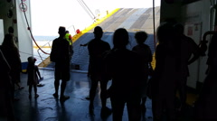 Tinos port, Cyclades. Passengers in Greek car-truck ferry with open door to port - stock footage