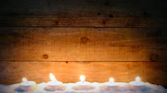 Candle flame on wooden background Stock Footage