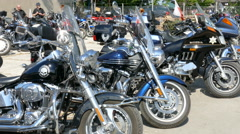 Harley Davidson Motorcycle at motorcycle rally Stock Footage