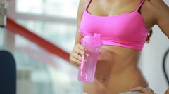 sportive female thirsty after active workout, drinking fresh water - stock footage