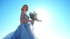 Bride in luxurious dress with a bouquet of flowers. - stock footage