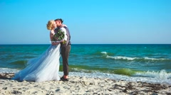 Couple in love on the beach coast ocean romantic pressed against one another. Stock Footage